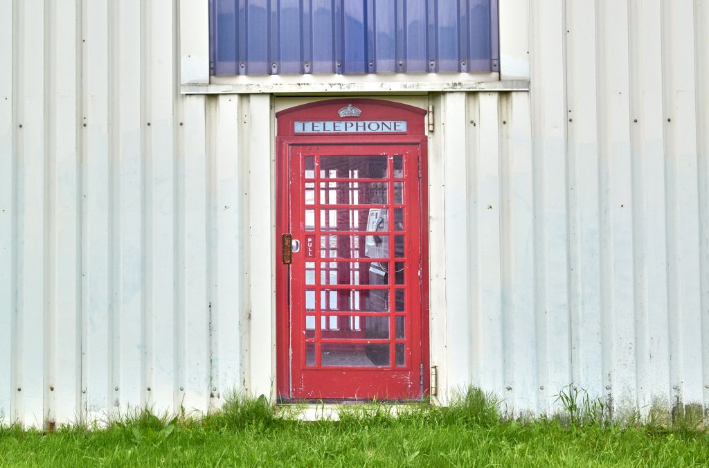 Telefonzelle in Container